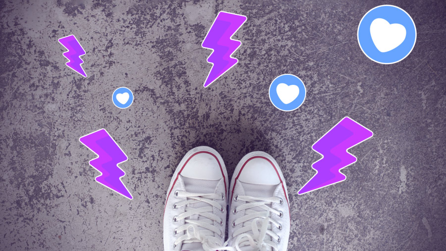 An image of sneakers on concrete, shot looking down, overlaid with lightning-bolt and heart stickers