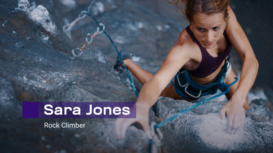 "An action shot of a woman rock climbing with a lower-third graphic that reads ""Sara Jones, Rock Climber"""