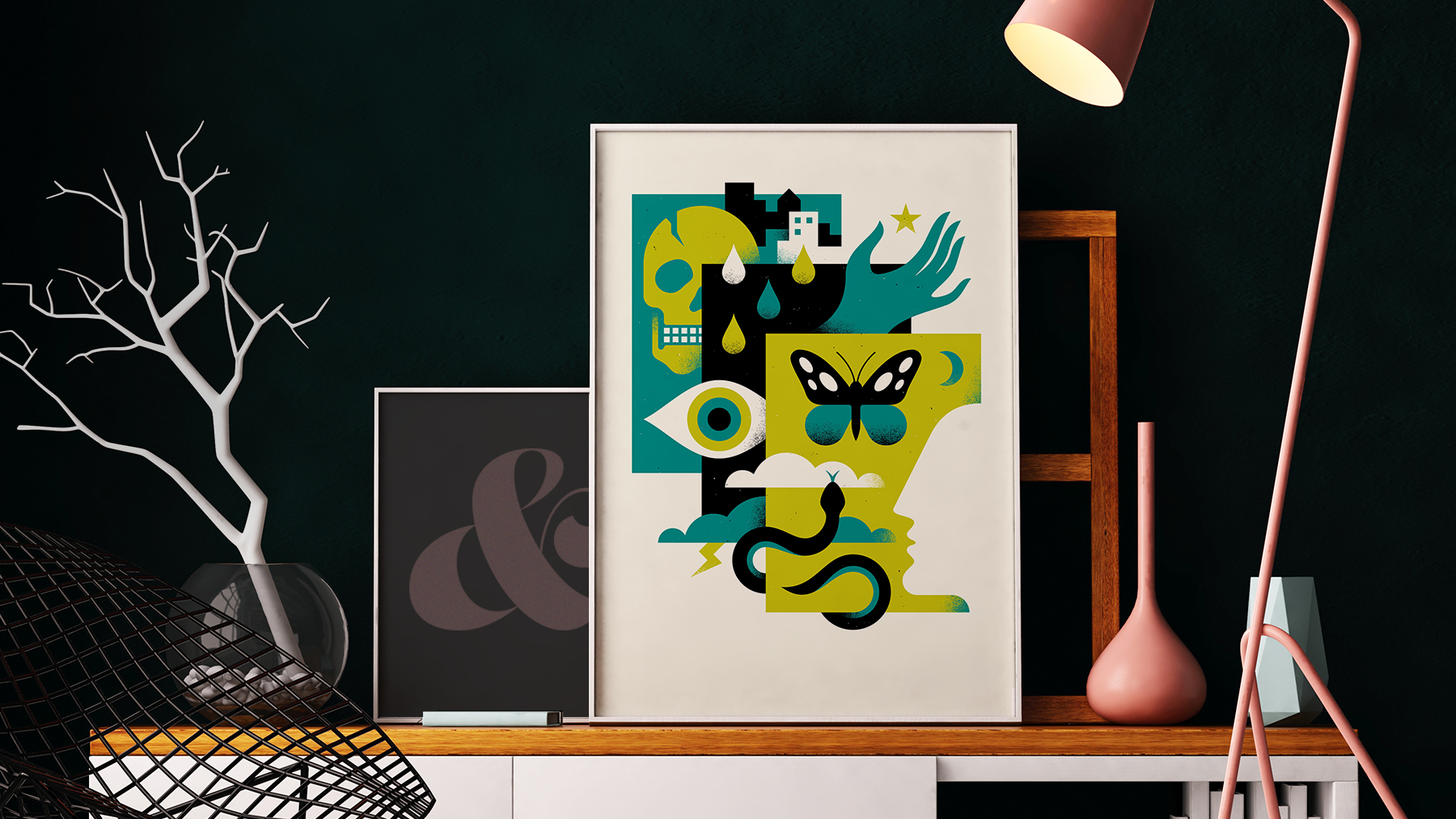A photo of a living room setting, with framed posters on display. The poster artwork is by Doublenaut Design for The National Poster Retrospecticus and depicts a geometric illustration containing a skull, snake, butterfly, hand, eye, and the silhouette of a person's face.