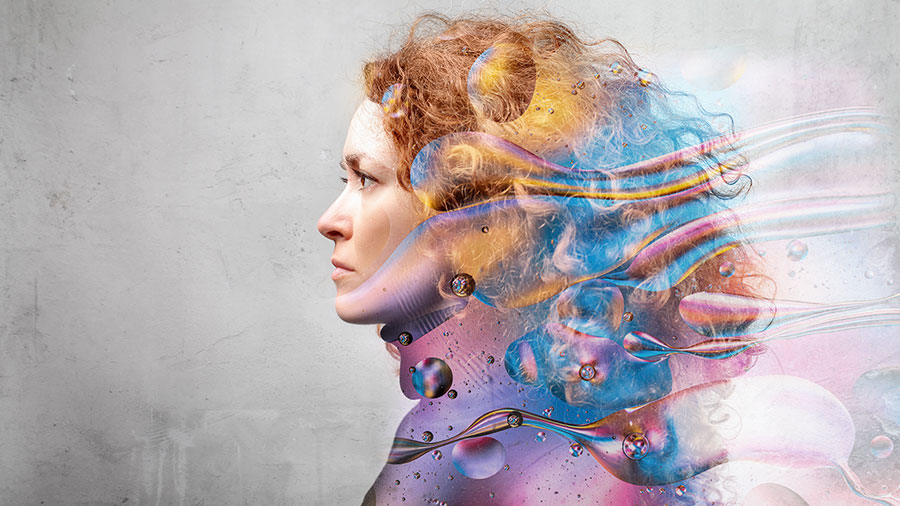 Profile of a woman's face with graphic designs layered over her hair