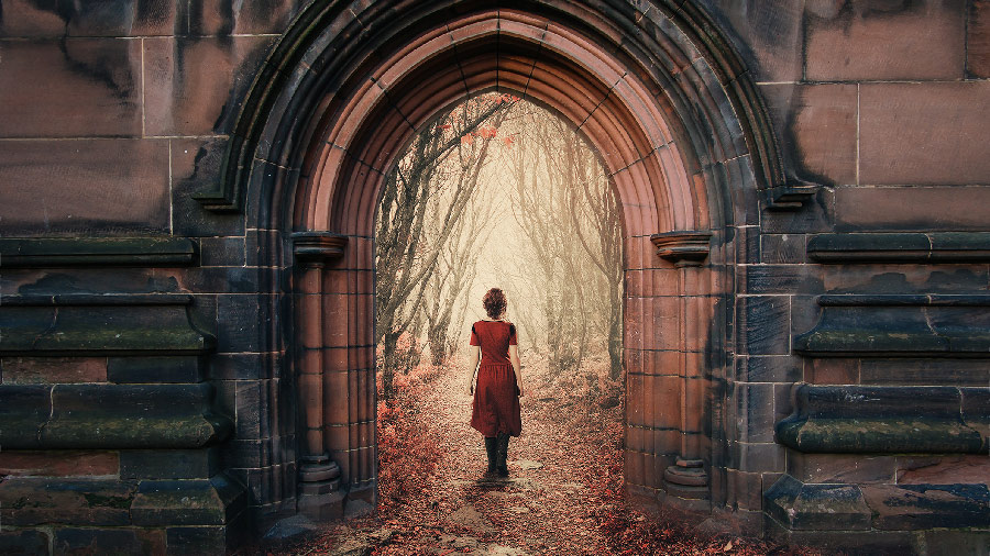 Woman in a red dress entering a building portal leading to a path in the woods