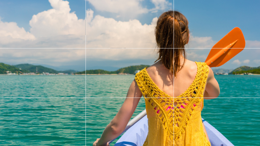 Image of a woman in a rowboat with a grid overlay