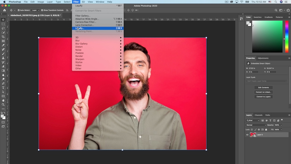 Photoshop workspace with the Filter > Liquify menu highlighted while the selected artwork displays a man making a peace sign on a red background