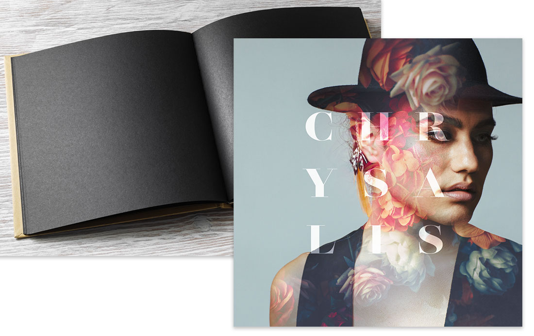 Blank book with black pages on the left and image of model and flower composite with the word 'Chrysalis' on the right