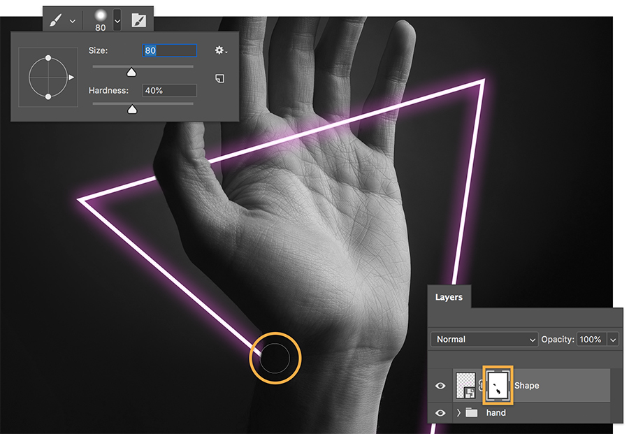 Brush with black to create photoshop mask to hide parts of the shape in front of the wrist and thumb