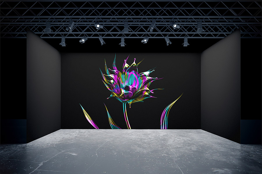 Final flower image projected on black wall behind a stage