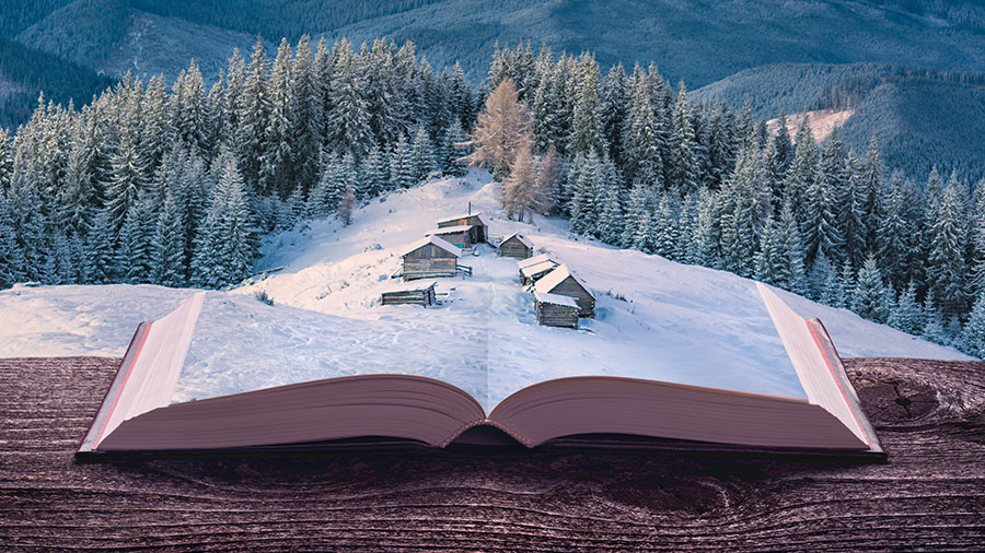Image showing a village collaged onto an open book book on a ledge overlooking a snowy landscape