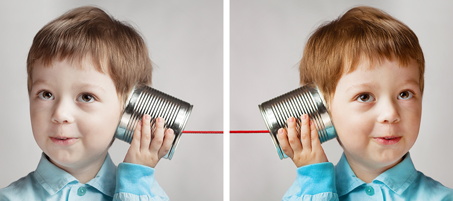 Side by side photos of a boy with a toy can phone, the right side image has been warmed up by removing a bluish tint