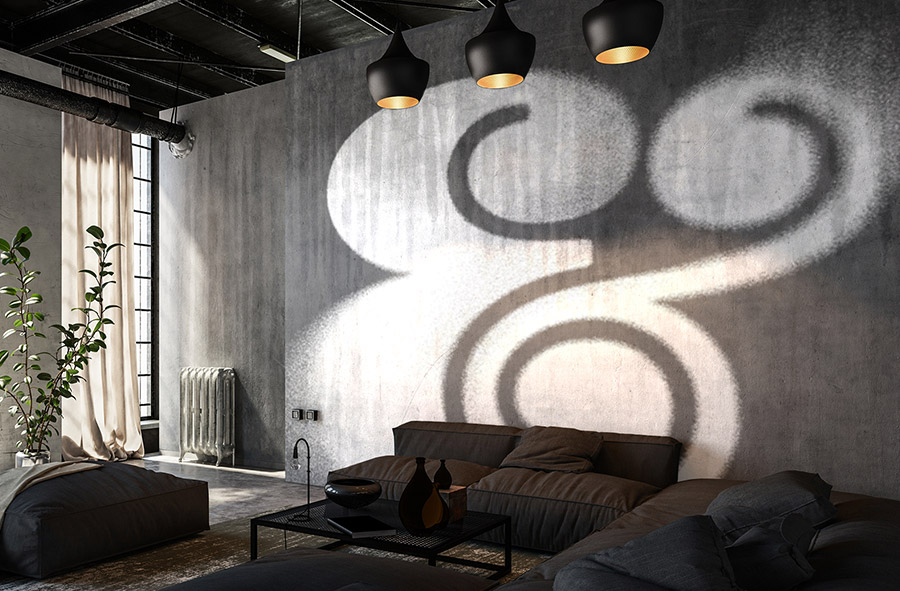 Ampersand with spray paint effects applied displays on a wall in a living room scene