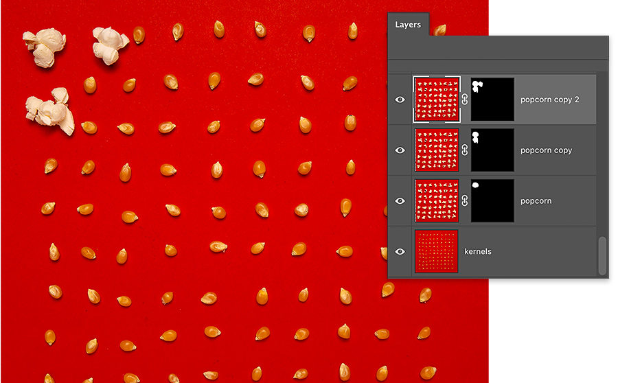 3 kernels of popcorn on red background are popped, remaining kernels are un popped, photoshop layers panel has 4 layers, 3 with layer mask