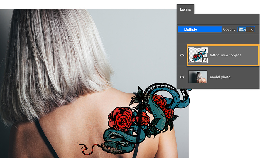 Add photoshop tattoo art image as new layer to model image and set blending modes to multiply