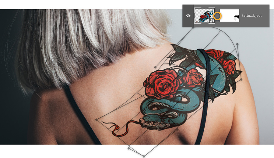 Use photo warp tools to fit image on to contours of the model's back and shoulder
