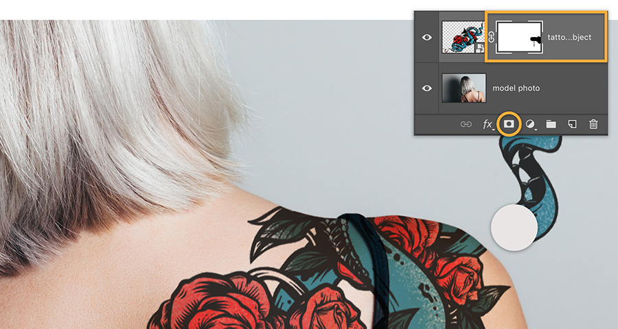 Add Photoshop mask to tattoo layer and brush to hide areas of tattoo that extend off the shoulder