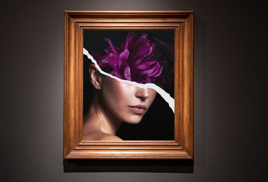 Composite image with model's face on the bottom, flowers on top, and rip in the middle displays in a frame on a gallery wall