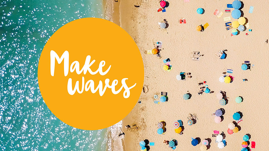 "Overhead photo of beach and ocean with a ""Make waves"" graphic"