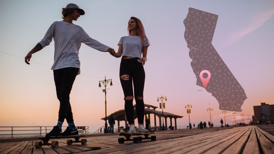 An image of two young skateboarders on a boardwalk at sunset with a California map graphic overlay