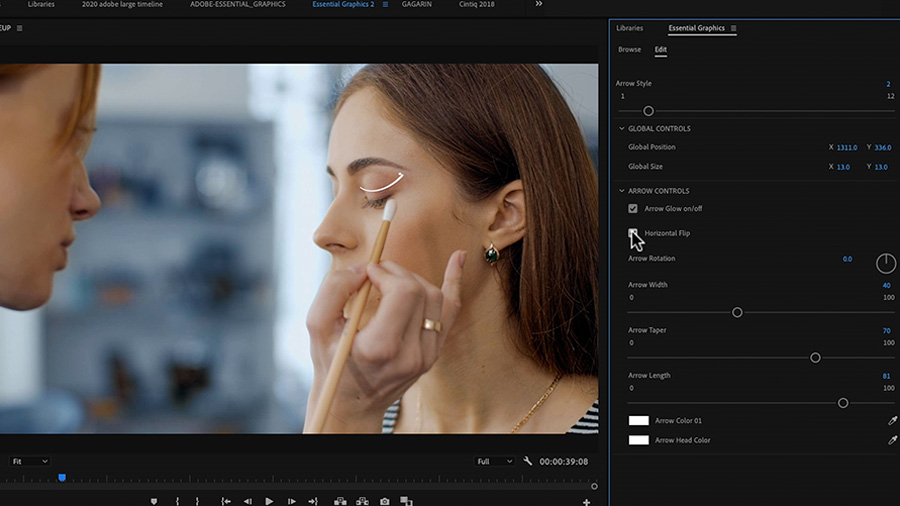 In an Adobe Premiere Pro desktop screenshot the Program Monitor shows a video clip of a young Caucasian woman applying makeup to the eyelid of another young Caucasian woman with an animated arrow depicting the motion, and the cursor is hovering over the Horizontal Flip button in the Essential Graphics panel