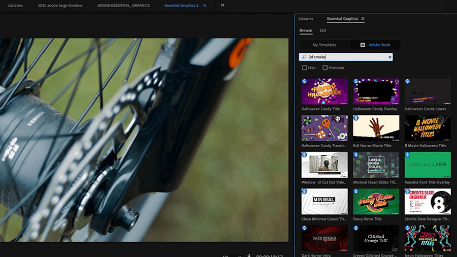 In an Adobe Premiere Pro desktop screenshot, the editor uses the Essential Graphics panel to search for Motion Graphics templates with the keywords '2d smoke', while an extreme close up on a mountain bike hub and disc brake is shown in the Program Monitor to the left