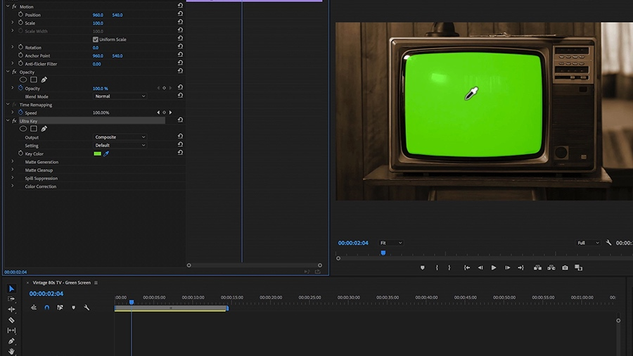In an Adobe Premiere Pro desktop screenshot, the editor is using the eye dropper tool from the Ultra Key effect to select the green screen on a vintage CRT television screen which sits on a small table in front of a wood paneled wall