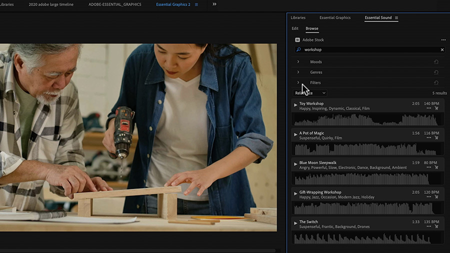 "In an Adobe Premiere Pro desktop screenshot focused on both the Program Monitor, which shows a young Asian woman and an older Asian man woodworking, and the Essential Sound panel, the editor has entered the term ""workshop"" into the search bar at the top of the Essential Sound panel"