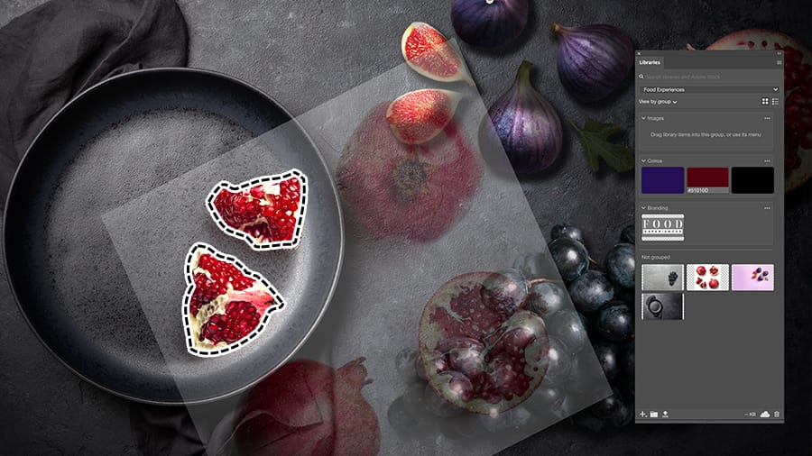 Image of pomegranate pieces imported, rotated and positioned over top of a bowl image in Photoshop.