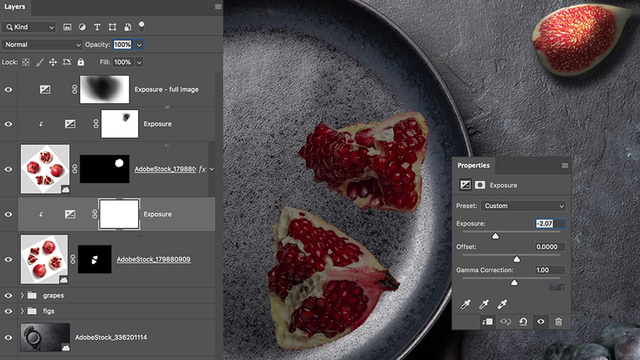 Adjust the lighting values and of the pieces of pomegranate by using an exposure adjustment layer in Adobe Photoshop.
